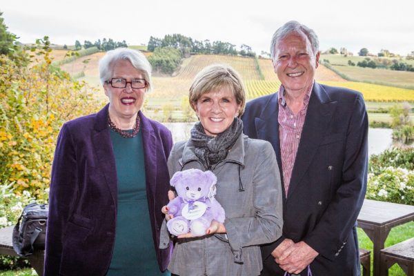 The owners of Bridestowe Estate with Bobbie the Bear held by Foreign Minister Julie Bishop.