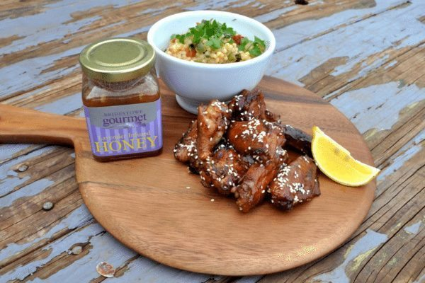 Chicken wings on table with Lavender Infused Honey.
