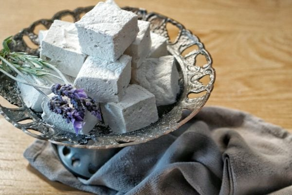 Lavender marshmallows on silver tray with lavender flowers.